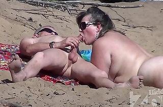 Blowjob on a nudist beach.  xxx porn