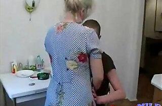 Grandson fucks his old granny in the kitchen.  xxx porn