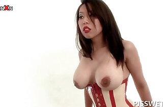 Piss lover sex slave in latex cunt spread in BDSM scene.  xxx porn