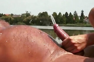 Dolly Diore has a golden shower with an old man by the lake.  xxx porn