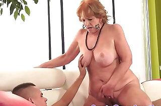 Chubby granny sucking on a cock riding it.  xxx porn