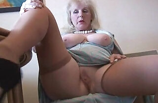 Curvy mature british milf lady in stockings strips and poses.  xxx porn