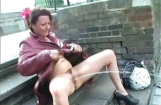Mature masturbating in public and squirting on pavements.  xxx porn
