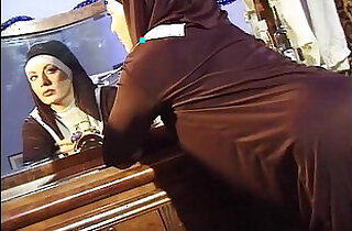 Dirty nun jerks off her pussy while shes spied on the keyhole.  xxx porn